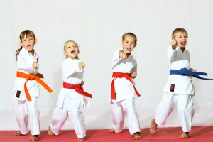 Four children in kimono hit a punch on a white background